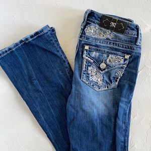 Miss Me Mid-Rise Boot Jeans. Medium wash, Bling pockets.